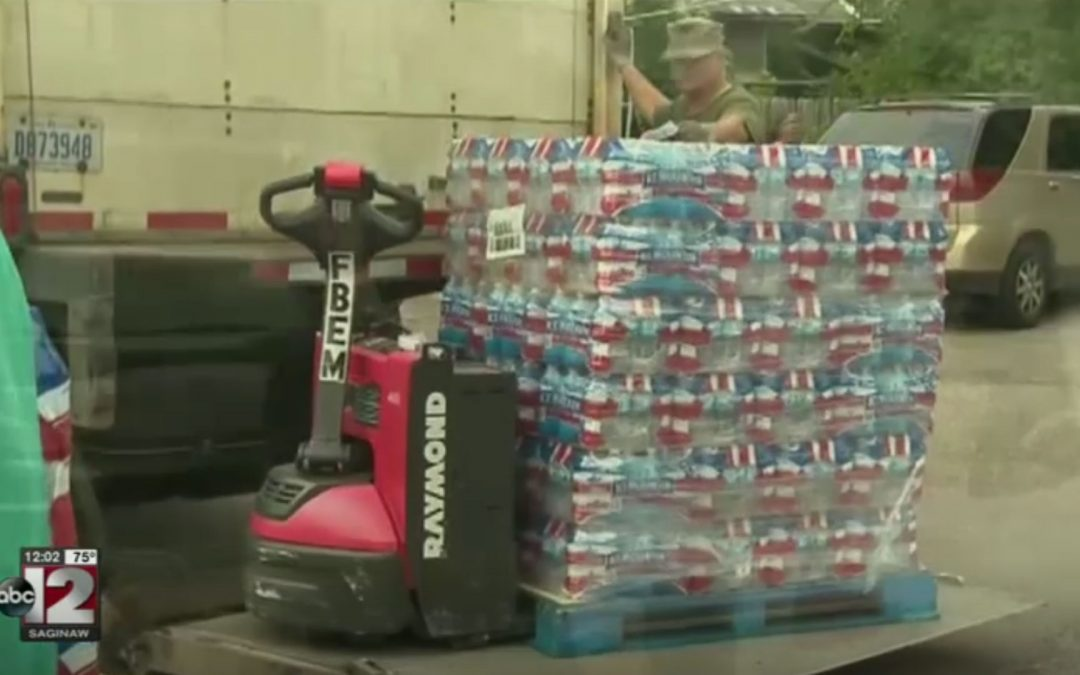 Church water distribution continues to draw large crowds